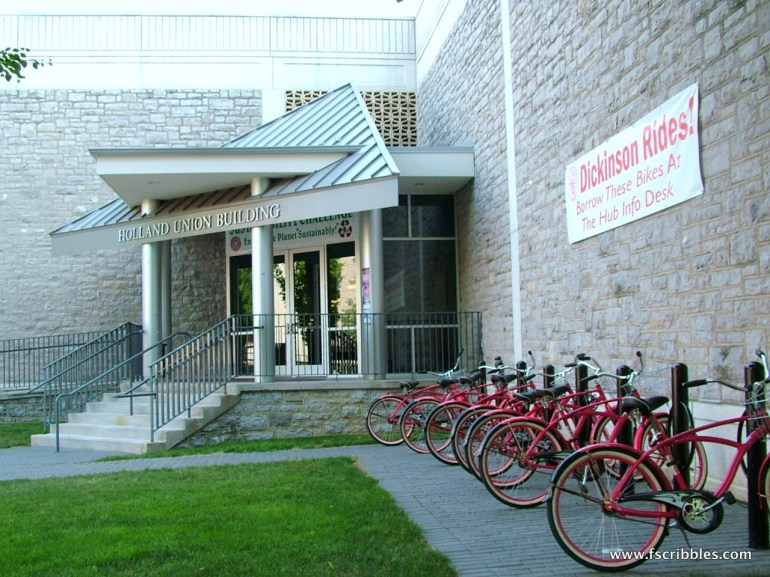 An old building, bikes and grass